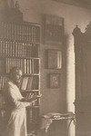 Прот.Н.К.Чуков в кабинете у библиотеки
